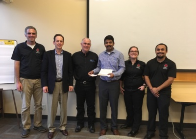 GEW's Managing Partner Brian Clarke presenting a check to Central WA University's Safety Health Management program to fund the Dr. Patton's scholarship (founder of Safety program at CWU and advisor to Clarke).