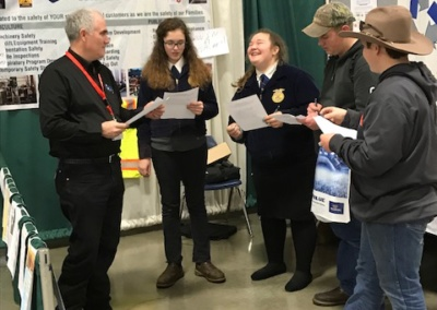 Partners Brian Clarke and Duane Grange at Willamette AG Expo testing local FFA students on their knowledge of the Food Safety Modernization Act.